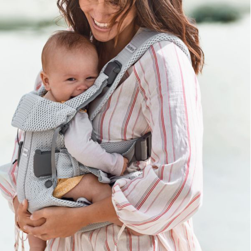 Babywearing: Keeping your work close and your babies closer!